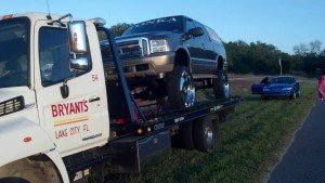 Bryant's towing an SUV with HUGE rims!